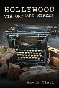 Book cover of Hollywood Via Orchard Street. Photo of a typewriter in rubble.